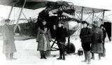 """Летчик В.С.Веселовский (третий слева) у своего """"Бранденбурга"""". Зима 1918 - 1919 г."""